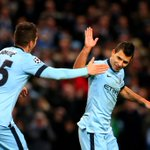 The great escape? @aguerosergiokun celebrates with @stevanj35. The strikers hat-trick keeps @MCFC alive in the #UCL http://t.co/1rGAcYxgfq