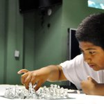 Roberto Jarquin, 11, makes his chess move against Salvador Galindo at the Breadbox Rec Center in #salinas #alisal http://t.co/k0v6SWYlyo