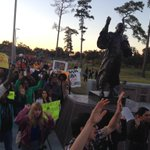 """""""Hands up, dont shoot!"""" Protesters at MLK statue in MacGregor Park. http://t.co/DlNV95yTh0"""