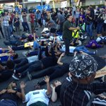 """Lying down in intersection MLK Crenshaw. Lapd starting to shut streets. @myfoxla """"facilitating """" protestors per Beck http://t.co/alZGfhBIzx"""