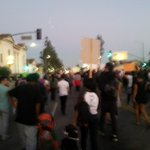 Daylight is waning the crowd is growing. Headed east on king. #LosAngeles #mikebrownverdict #mikebrownprotest http://t.co/jbQmqUyLgh