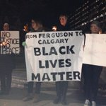 Crowd at Calgary City Hall chanting One solution! Revolution! From #Ferguson to Cowtown, support #MichaelBrown http://t.co/wWaT9rKeIE