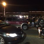 Protesters chanting and blocking street outside #Ferguson PD. Organizers trying to calm things http://t.co/CgzmzpbVOc