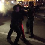 Cops are in riot gear, have guns and batons. Rocks thrown. Girl maced. #ATLFerguson #atlshutitdown http://t.co/WElquoRlV5