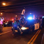 Protesters escalate confrontation as they surround LAPD and climb on cars in day 2 protest. #MichaelBrown #Ferguson http://t.co/el6HnelNIR