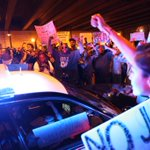 Confrontations escalate as LAPD stuck under a freeway in Hope street. #MichaelBrown #Ferguson protest day 2. http://t.co/A5j42tzTKk