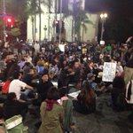 Demonstrators are doing a sit down at the intersection of Adams and Figueroa in #DTLA #FergusonVerdict http://t.co/YklZthjUZE