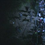 Marchers break thru fence leading to 110 off Figueroa near 22nd. Watch: http://t.co/5lQe9Nrxc8 http://t.co/kdXErqnYA6