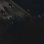 Crowd of protesters takes over 101 Freeway in #DTLA; officers try to clear scene (@KTLA photo) http://t.co/HgSS1JYh4y