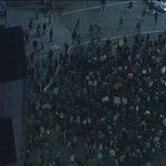 Demonstrators make their way to downtown L.A. on Figueroa http://t.co/5lQe9Nrxc8 http://t.co/rILUsi58eO