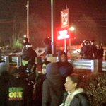 Protesters attempt to enter W Florissant. Riot police push back, move to protect Walgreens. #Ferguson http://t.co/UsIbAxagVl