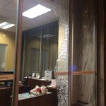 Smashed window at a Wells Fargo in downtown Atlanta. Police in riot gear now lining the streets. #ATLFerguson http://t.co/ze3o9Wdlw5