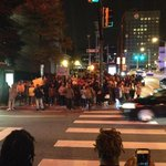 "Protestors now gathered on SE corner of Peachtree and Decatur. ""No justice, no peace"" #atlferguson http://t.co/AwJ3BPCH77"