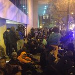 Group now sitting in protest on Marrietta Street in Downtown Atlanta. @wsbtv #Ferguson protest http://t.co/O6AG1cofo7