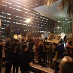 About a thousand in the street in front of LAPD HQ. #LosAngeles #mikebrownprotest http://t.co/WL6m1FuavR