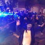 #atlprotesters walking down Baker past World of Coca Cola. Hands up, peacefully defying cop orders. #ShutItDownATL http://t.co/Dg8u9n9KUo
