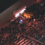 Several hundred #Ferguson protesters hold their position outside LAPD HQ. Live coverage: http://t.co/NepRVVitv4 http://t.co/uCMg0aJLXa