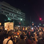 Protesters flooding into street to close intersection outside LAPD HQ http://t.co/EUCrPZhu4m