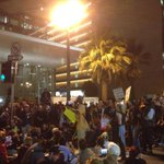 Huge gathering as protesters grow in number outside LAPD hq in downtown LA. #Ferguson #MichaelBrown http://t.co/AcPH5Y2Xdu
