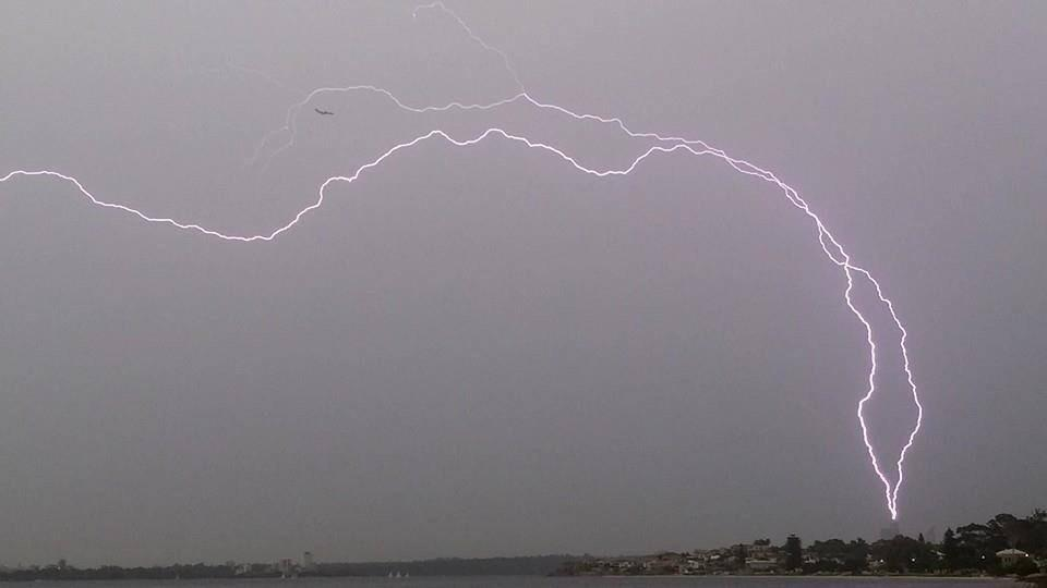 If you look closely, you can see a commercial jet got close to being hit by lightening over #Perth today http://t.co/1TBEhdp85K