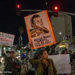 Protesters march up Figueroa Street toward LAPD headquarters, blocking traffic. http://t.co/ljG5KXx0ZX