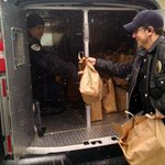 Officers Magyera and Beckfield loading 80+ turkeys into an MPD van to distribute in the Triangle Neighborhood. http://t.co/qWtnCYOwQv