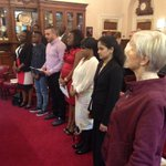 The new citizens stand for the National Anthem. #OurDay #wigan http://t.co/DJ7eynQDUU