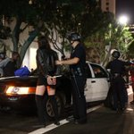 LAPD officers go through the motion of arresting a large number of protesters in an orderly fashion. #MichaelBrown http://t.co/9KgYYm0uNM