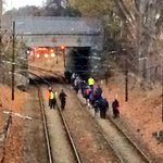 Few dozen passengers walking down tracks to waiting bus, after trolley collision in Dorchester #WCVB http://t.co/ggCNd2htLf