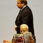 Pakistani PM Nawaz Sharif walks past PM Narendra Modi during the 18th Saarc summit in Kathmandu on Wednesday. PTI http://t.co/YkczhTLGSh
