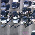 #ALERT: A protest is shutting down the (South) 101 near Alvarado. Stopped all the way back to Sunset. http://t.co/Uggytyv9s5