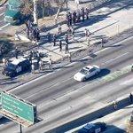 UPDATE: Protest on side of 101 Fwy slows traffic near Alvarado Street. http://t.co/etpbLEtjIg http://t.co/FCrEO8kvVh