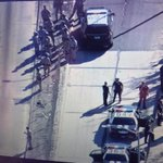 Protesters on their way to jail..101 has reopened in both directions at Alvarado St. Traffic still jammed @myfoxla http://t.co/AbUVEtQRnd