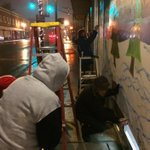 #Ferguson residents volunteer to paint boarded up buildings. At night. In the snow. http://t.co/dO6JIRr4IU