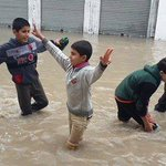 #Palestinian children play in the #rain flooded #today in #Gaza .. #Gaza_is_sinking #SaveGaza #GazaNeedHelp http://t.co/0cH4umJbfF