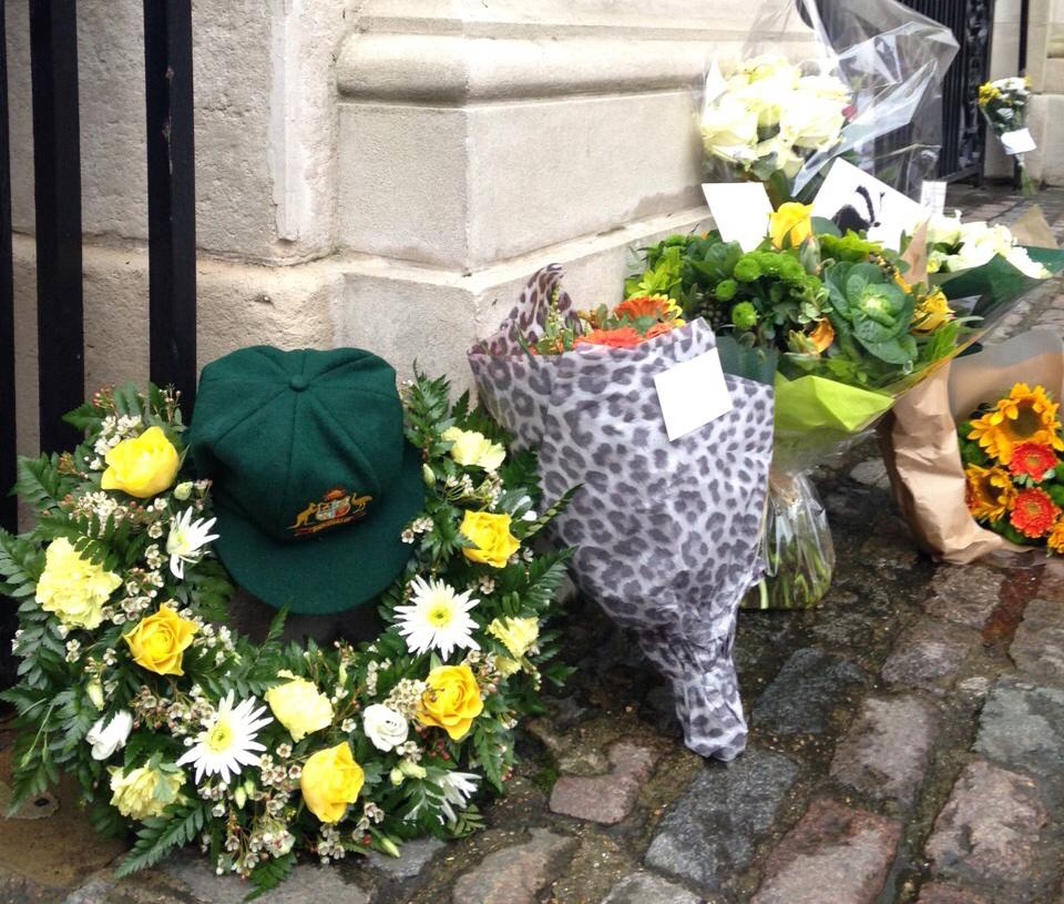 Flowers and a baggy green. #PhilHughes tributes at the Lord's Grace Gate today: http://t.co/dtPwEOxkvK