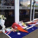 Tributes to Phillip Hughes outside the Cricket NSW office in Sydney #putoutyourbats #63notout http://t.co/whKZ4FvjUN