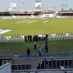 Players and officials observe a minute silence for Phillip Hughes at Sharjah. Pic via @AzlanKhan7 http://t.co/gw3xXfycnj