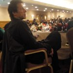 chairman PTI Imran Khan watching presentation slides regarding massive rigging in elections.. #IKpressCon http://t.co/Z637cm836L