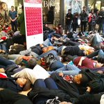 4.5 minutes of silence. Bodies on the floor to represent #MikeBrowns blood on the ground. #BlackoutBlackFriday http://t.co/5CCH5htZ4o