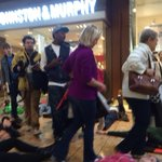 Shoppers stepping over prone bodies of protesters... Symbolism much? #Ferguson #NotOneDime #BlackFriday http://t.co/hCQqYthTVZ