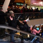 Photos: Hundreds of #Ferguson protesters storm into 2 #Seattle malls during march. Now headed to Cap Hill #MikeBrown http://t.co/MSlk9ezSMo
