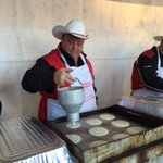 Calgary Councillor @Joe_Magliocca serving up pancakes to #CFL fans. Picking #Stamps to win 31-17. @nenshi #GreyCup http://t.co/NhEH31N043