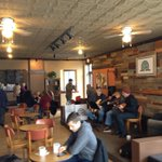 30+ people at Daily Planet Coffee Shops grand opening on Hertel. Live music all day, too. http://t.co/L1jomSjylc