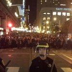 Police holding back other side of street also. #BlackFridayBlackout #SF #MikeBrown #BlackLivesMatter #Ferguson http://t.co/WmXwleaotf
