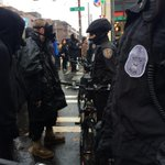 Protesters in gas masks staring down @SeattlePD officers. #Ferguson #Seattle http://t.co/sZpTgK3UD4