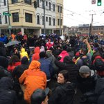 Moment of silence with raised fists at Broadway and Pine. #BlackLivesMatterFriday http://t.co/jEHLLXDVm9 http://t.co/XABwFGrAyr