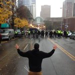 Theres a standoff at Boren and Pike. Protesters are preparing for tear gas. http://t.co/jEHLLXDVm9 http://t.co/Ets26wrAlK
