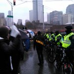 Umbrellas also being readied as shields by protesters at Pine/Boren RT @CaseyJaywork: http://t.co/qgBqBrjbLi