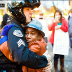 """Powerful image comes out of protest in Portland -- as 12-year-old holds """"Free Hugs"""" sign http://t.co/D2wzsuOA4S http://t.co/2yXX71yxne"""